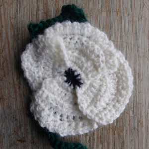 A crocheted white poppy